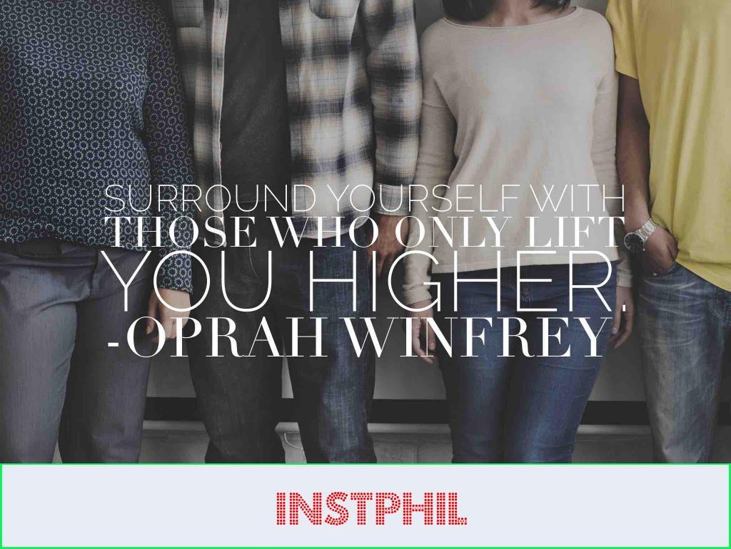 Four friends sharing an Oprah Winfrey quote about positivity