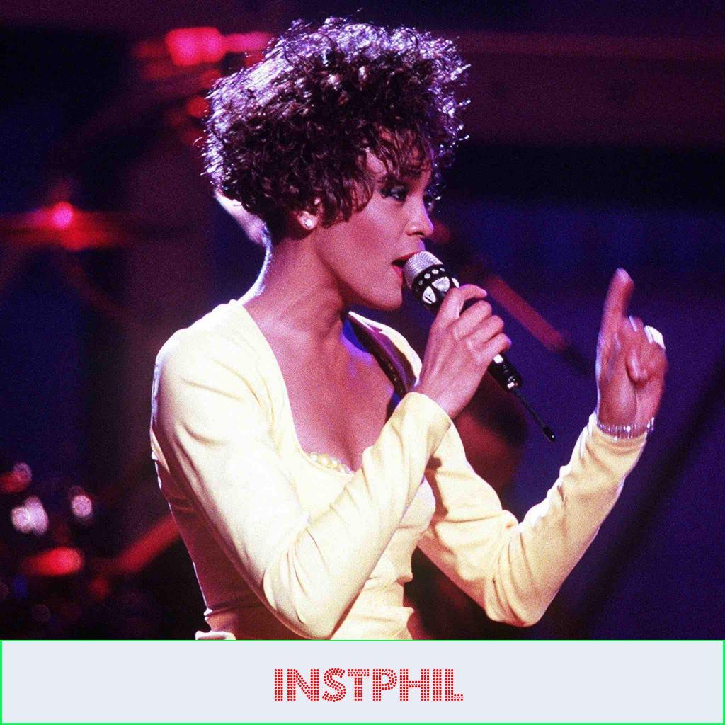 Whitney Houston singing inspirational songs with lyrics to motivate